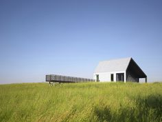 Weekend Cabin: Huron County, Ontario. This off the grid house in Huron County, Ontario mimics a steel grain shed and was designed to reflect the local agricultural heritage.