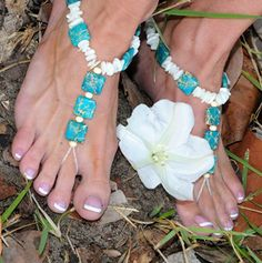 Titivate your toes with this blue bejeweled foot accessory! Designed to be worn with or without shoes, seed beads wrap around the second toe with ease so you feel total comfort when you slip them on and around the ankle. Crafted with only semi-precious stones and real shells, these decorative delights will dress up any shoe or ensemble.