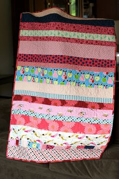 strippy baby quilt by a quilt is nice