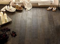 It's not wood...it's tile that looks like wood! A great solution for a bathroom, spa, outdoor area... fabulous idea!