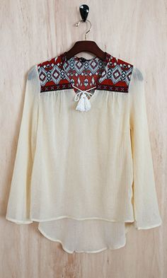 This earthy aztec print top is full of personality, and boasts a gorgeous shape.
