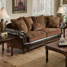 7500 Faux Leather And Fabric Sofa With Rolled Arms Nailhead Trim Becker Furniture World
