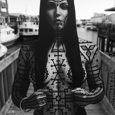 Illuminated Transformation Series: Tattoo Visions hand drawn and embellished on photograph. Pen and ink on paper, with the figure cut out and photographed - standing in front of the ferry terminal in the Old Port District, on the solid ground of the Euclidean Primal Plane.  For extensive (or minimal) coverage inspired by this series, please contact me via email.