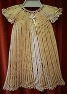 Heirloom Crochet Christening Dress free crochet pattern - i like the vertical lines and the details around the sleeve and neck line.  also like the bow