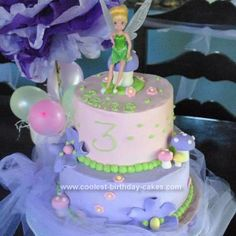 Homemade Tinkerbell Cake: I made this homemade Tinkerbell cake for my daughter's 3rd birthday.  The bottom was an 8 round and the top was a 6 round covered in butter cream icing.