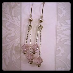 Lavender Swarovski crystal earrings Beautiful lavender Swarovski crystal earrings.  Approximately  1 1/2 inches long.  Matching bracelet available. Jewelry Earrings