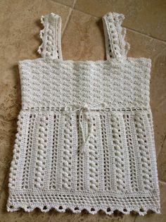 From the description: When it comes to lace, crochet shines! This intermediate-level design, carefully choreographed by Valerie Kurita, is worked in Cool Crochet from Bernat and boasts a bevy of pattern stitches.