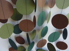 Like this option for Archer's party...more clean looking and modern.     Camouflage (Camo) Birthday Party Garland, Green and Brown. $10.00, via Etsy.