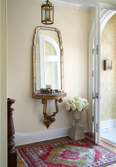 Don't like the mirror, but like the idea of a floating table with mirror in entryway.