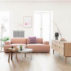 mixed height cocktail tables + clean lines couch + funky natural sideboard