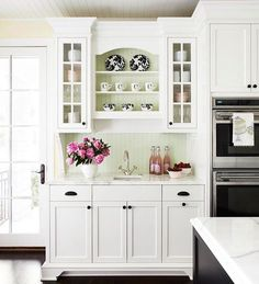 Traditional Kitchen with Standard height, Glass panel, Crown molding, Hardwood floors, Cabinets, Flush, Undermount sink