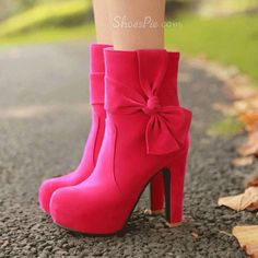 thick heeled bow boots in hot pink