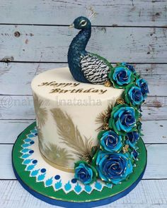 love when I'm asked to create a cake based on a subject I admire. So when the subject was a peacock I was very excited! I've had a little box of peacock related cake tools and I finally got to use them! This cake was inspired by one made by. Peacock Cake, Peacock Wedding Cake, Wedding Cakes, Peacock Birthday Party, Peacock Cupcakes, Peacock Theme, Pretty Cakes, Beautiful Cakes, Amazing Cakes