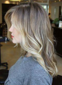 Dark ash blond with highlights.