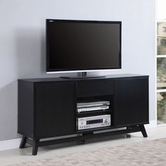 Coaster Furniture Brown TV Console with 2 Open Shelves. Crafted of solid wood with veneers. Black finish. 2 Cabinet doors. 1 Drawer and 2 Open shelves. Maximum TV Size: 65 in.