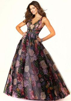 Size 0 & 4 in Black/Multi - Style 45084 from Morilee by Madeline Gardner is a sleeveless Floral Patterned Net prom ball gown with a ruched V neck bodice and Jeweled Waistband. Floral Prom Dresses, Designer Prom Dresses, Grad Dresses, Prom Dresses Online, Lovely Dresses, Strapless Dress Formal, Short Dresses, Formal Gowns, Formal Wear