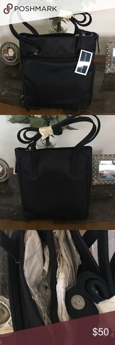 NEW JENNIFER MOORE BAG NWT JENNIFER MOORE BAG.  Black canvas bag with 2 separate compartments Inside, & a center zipper compartment in between.   The front has a compartment with a phone holder, credit card slots, a pen holder, a Velcro pocket and an additional coin purse which is still attached.  Brand new with the tags attached. Refer to pics.  Questions welcomed. Jennifer Moore Bags