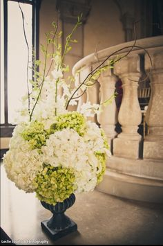 green and white floral for ceremony.  hydrangea, orchids and calla lily.