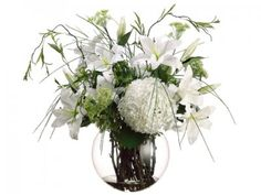 Price: $419.99This is probably one of our most elegant and majestic Silk Flower Arrangements here at BestSilkFlowersbyEmery. Beautiful Casablanca and Annabelle blooms are displayed in a clear vase with liquid illusion water, towered by strands of Grass that add to the fullness of this arrangement. It stands 29 inches in heights and can be the focal point of any event that warrents something extra special. No matter where you display it, it will be a conversation piece and admired by all. 29H…