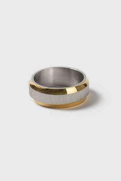 Mixed metal look stainless steel band ring with brushed insert. #Topshop