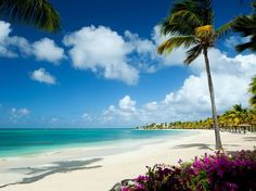 """10. Jumby Bay, Antigua. """"Totally over the top yet tastefully so—it's like living in a dream."""" Named for the local patois word for a playful spirit, this former sugar plantation on a private island has room palettes of pale cream and café au lait, with bright coral and jewel tone accents."""