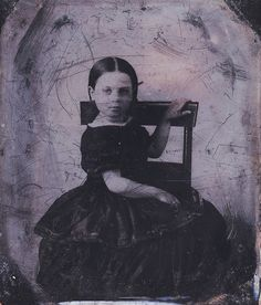 A worn and scratched uncased 1/6 plate 1850s tintype