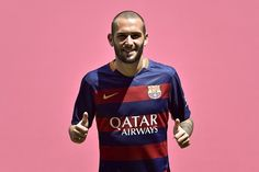 Barcelona's new Spanish defender Aleix Vidal gives the thumbs up as he poses with his new jersey during his official presentation at the Camp Nou stadium in Barcelona on June 8, 2015