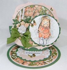 """The little image swings around.  Inside it's says """"Tickled pink for you, Congratulations!"""