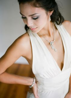 """How To Choose Your Wedding Day Jewelry."" Short and to-the-point with great tips about matching your gown neckline and style with jewelry."