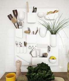 Pocket wall organizers used to keep kitchen utensils in order and easy to find. Similar, individual pocket organizers are available from Normann Copenhagen.
