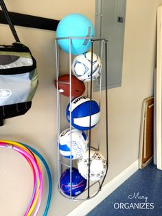 The best way to store balls ever-have also seen this using an open rectangle cabinet with cords in place of door