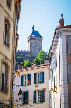 Place St Volusien  The multiple towers of Chateau de Foix can be seen from many angles as they loom over the medieval Midi-Pyrenees town of Foix in the South of France. @Deborah Harmes