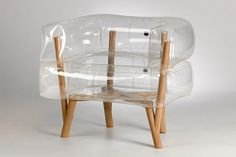 Anda armchair is an inflatable chair which features translucent, inflated parts, a wooden frame and legs and presents modern furniture design for contemporary nomads