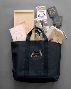 """Welcome tote bags held """"survival"""" supplies like gin and tonic and hors d'oeuvres kits, The mother-of-the-groom's walnut–chocolate chip cookies, and cozy pashminas. #weddingsurvivalkit #welcomebags #weddingwelcomebags #weddingdetails 