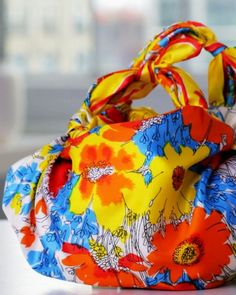 Knotted Handkerchief Purse  Take a vintage scarf and turn it into a cute new handbag. It's easy to create with just a few knots and a great way to incorporate beautiful scarves into your wardrobe.