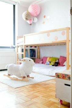 LOTS of good ideas for using the Ikea Kura kids' loft bed via Kidsmopolitan. White bedding too!