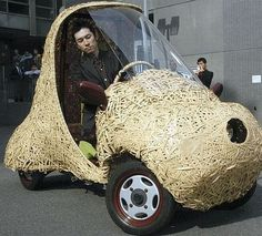 'BamGoo' – A Bamboo car that runs on electricity. The single-seat car was displayed in Kyoto City, western Japan. The 60-kg electric car can run for 30 miles on a single charge
