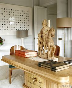L'Wren Scott + Mick Jagger's Paris living space with a Damien Hurst spots in the background