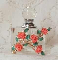 Perfume bottle with roses