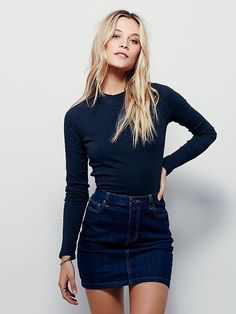 Jackson Denim Skirt | Slightly stretchy high-waisted denim mini skirt with an A-line silhouette that hits mid-thigh. Features traditional five-pocket design and a classic zip-fly with button closure.