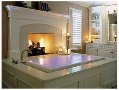 dream bathroom! except i would go with a double-sided fireplace