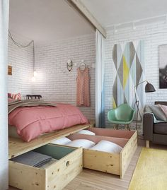 False floor under raised bed makes extra storage for linen and pillows