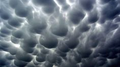 These eerie mammatus clouds appeared over a high school graduation ceremony in Pekin, Ill., on May 22, 2011, as part of the tornado outbreak that produced the devastating Joplin tornado the same day. (Credit: iWitness Weather/Candi Carter Kupris)