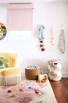colorful kids room with yellow velvet chair with fringe. / sfgirlbybay