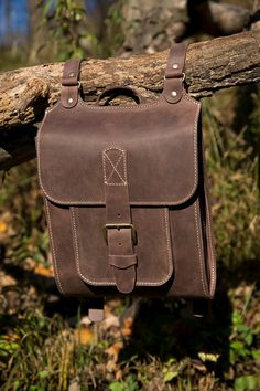 Backpack. Brown handcrafted leather backpack. $150.00 USD Buy today- https://www.etsy.com/listing/213264446/midle-size-menwomen-leather-backpack?
