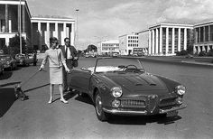 Audrey Hepburn (in suit by Givenchy, Ray-Bans, Roger Vivier shoes), with Mel and Mr.Famous getting in their Alfa Romeo convertible, photo by Pierluigi Praturlon, Rome, March 1961
