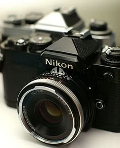 I don't know if I should get Canon, or Nikon, now that I'm okay without having a Polaroid camera...