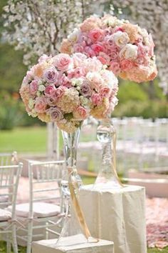 Balls of roses in tall elegant vases present a stunning view and setting....