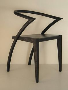 Asia Chair,  black leather sophistication.