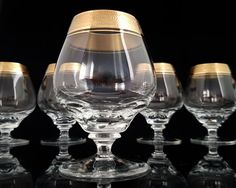 """Rare Mid Century crystal cognac glasses with a gold rim manufactured by THERESIENTHAL in W. Germany.  Decor: Concord with Mintonborte. This is a classical series from 1950s. Typically for this period, it combines elegance with function. Each glass is decorated with rich textured gold rim, the """"Mintonborte"""".  In very good vintage condition with no damages. Please see the pictures for more details.  Each glass is 100 mm (3.94) high. Diameter at the top 45 mm (1.77).  Weight 215 g (0.47 lbs)…"""